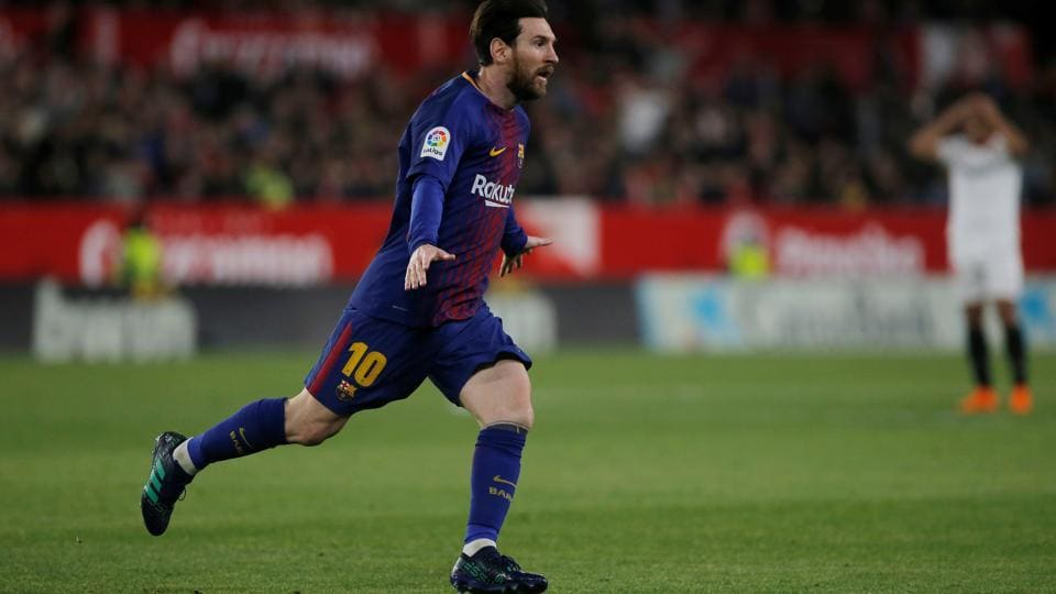 Lionel Messi rescued FC Barcelona's unbeaten season on Saturday as the La Liga leaders scored twice in the last three minutes to snatch a 2-2 draw at Sevilla.