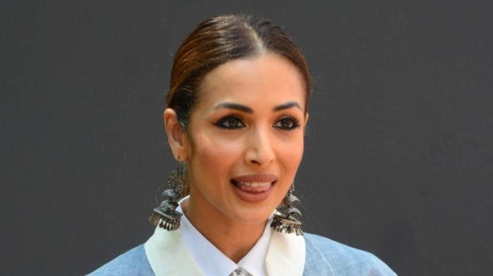 An ethereal white dress sings summer like nothing else, as demonstrated by Malaika Arora. Scroll to see her dress. (IANS)