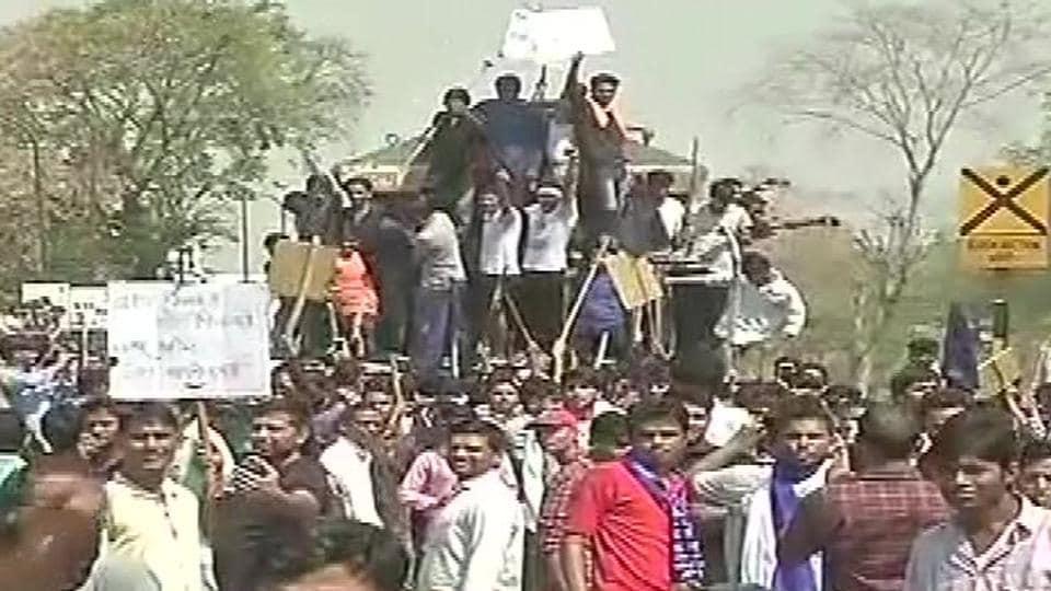 Protestors stop a train in Jaipur.