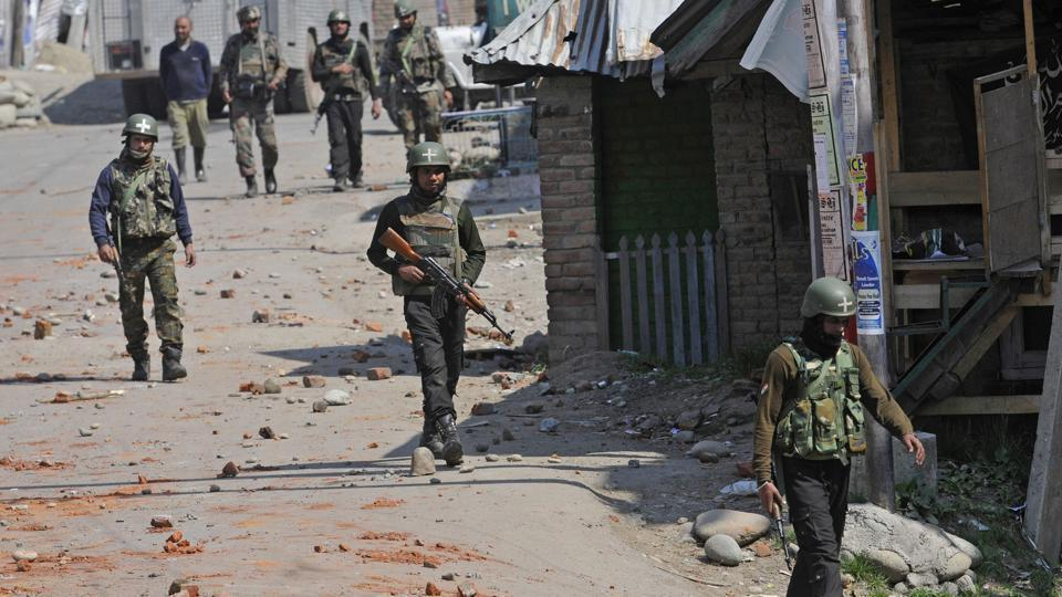 Army soldiers after a gun battle between militants and security forces in Shopian, South Kashmir, on Sunday.