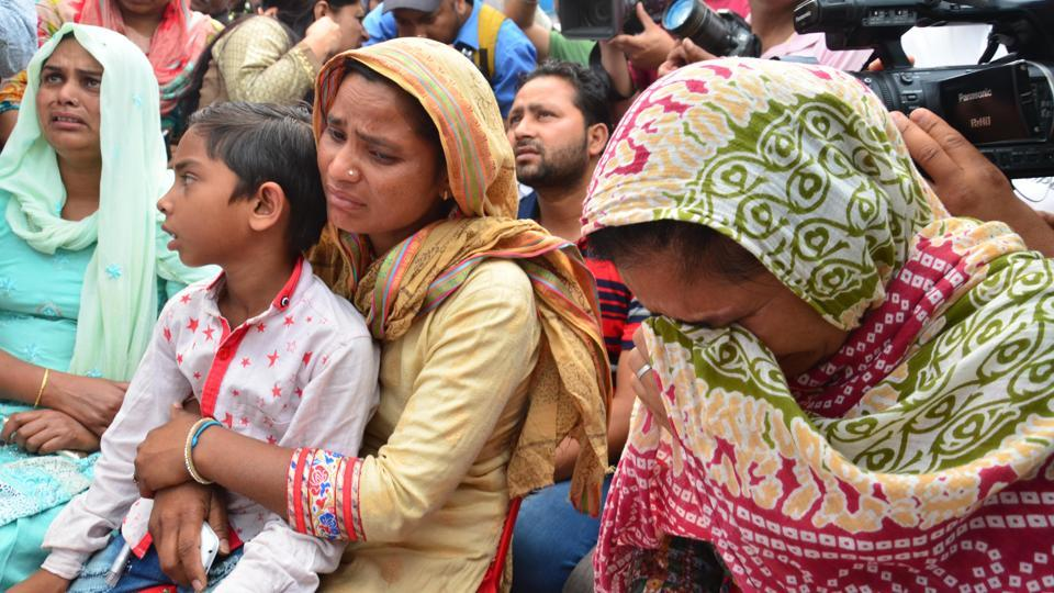 Family members of those killed in Iraq mourn after receiving the mortal remains of the victims brought back from Iraq,  at Sri Guru Ram Dass Jee International Airport in Amritsar on Monday.  (Sameer Sehgal /HT)