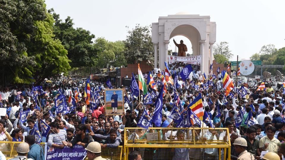 Members of the Dalit community and allied organisations shout slogans during a countrywide strike against the Supreme Court's order which allegedly diluting the Scheduled Castes and Scheduled Tribes (Prevention of Atrocities) Act 1989, in Hazratganj, Lucknow. (Subhankar Chakraborty / HT Photo)