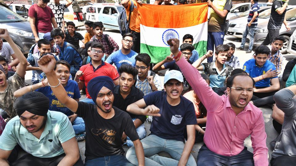 Class 10 and 12 students hold protests against the question papers' leak outside CBSE office in Preet Vihar in New Delhi on March 31.