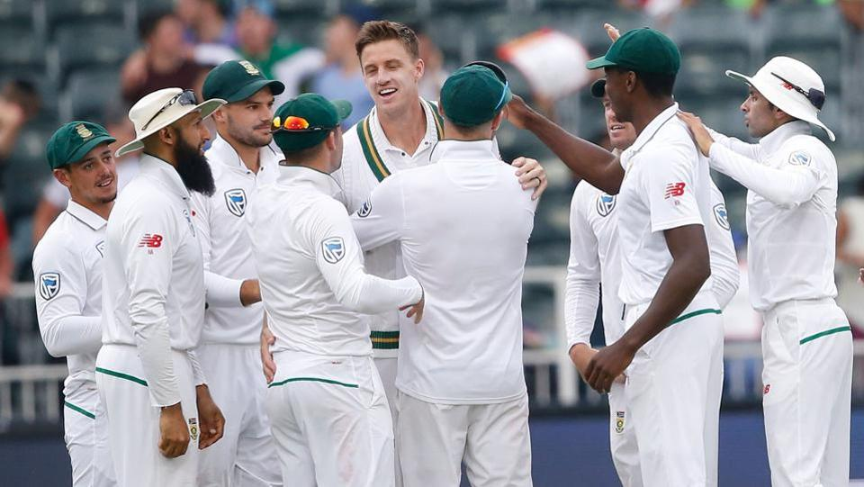 South African bowler Morne Morkel (C) celebrates the dismissal of Australian batsman Joe Burns (not in picture) on the fourth day of the fourth Test at Wanderers cricket ground on Monday.