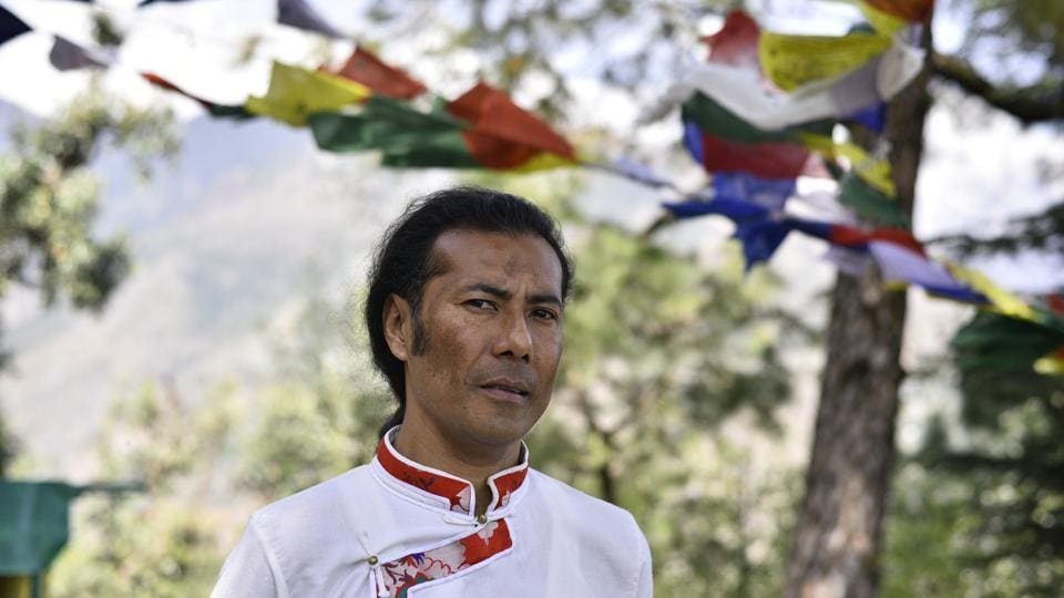 "From fake documentation to sham marriages people make every possible effort to move out of India. ""Agents get fake documentation made and charge differently for each country. The going rate for the US, for instance, is about Rs 20 lakh,"" says Lobsang Wangyal, a journalist and the organiser of the Miss Tibet beauty pageant. (Anushree Fadnavis / HT Photo)"