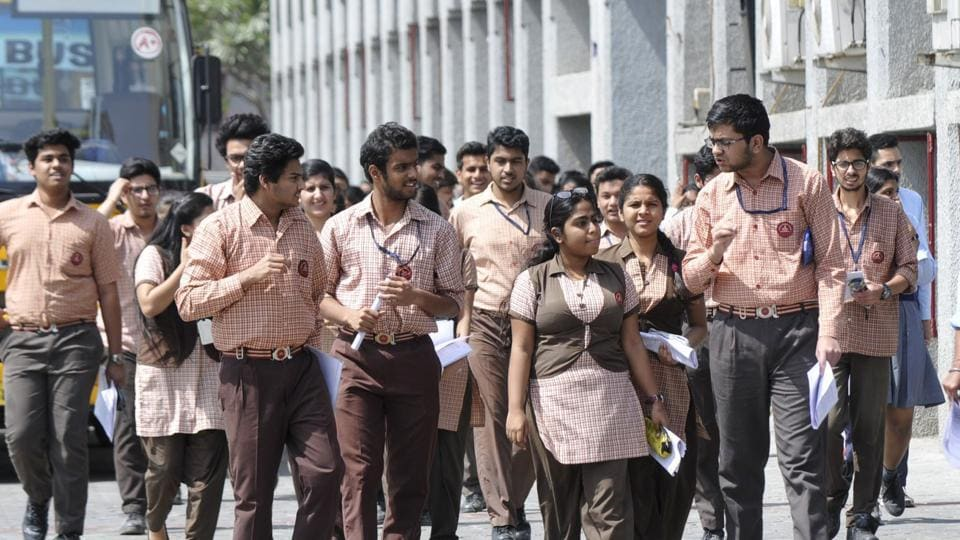 Students of Class 12 coming out after writing CBSE board examinations in Noida on  March 26.