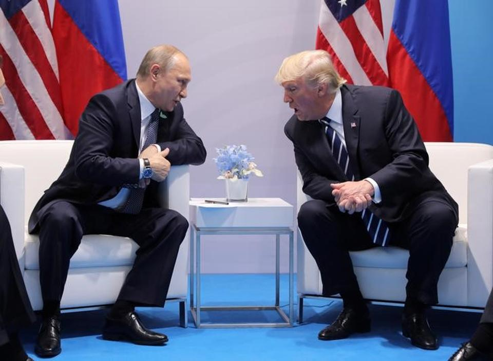 US President Donald Trump speaks with Russian President Vladimir Putin during the their bilateral meeting at the G20 summit in Hamburg, Germany July 7, 2017.