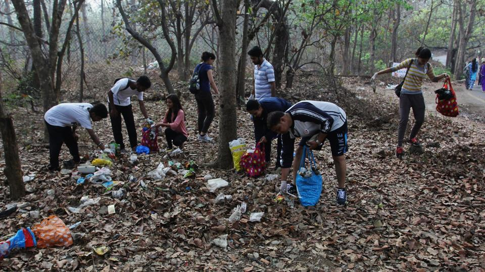 Residents clear plastic waste during the plogging event.