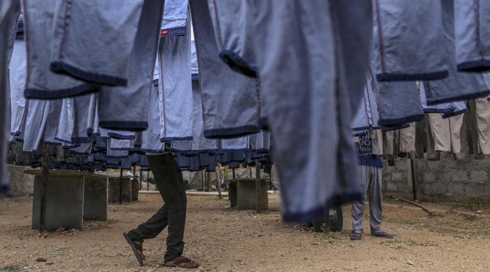 Denim jeans hang drying outside Krishna Jeans Washers factory at an apparel park in Ballari, Karnataka.