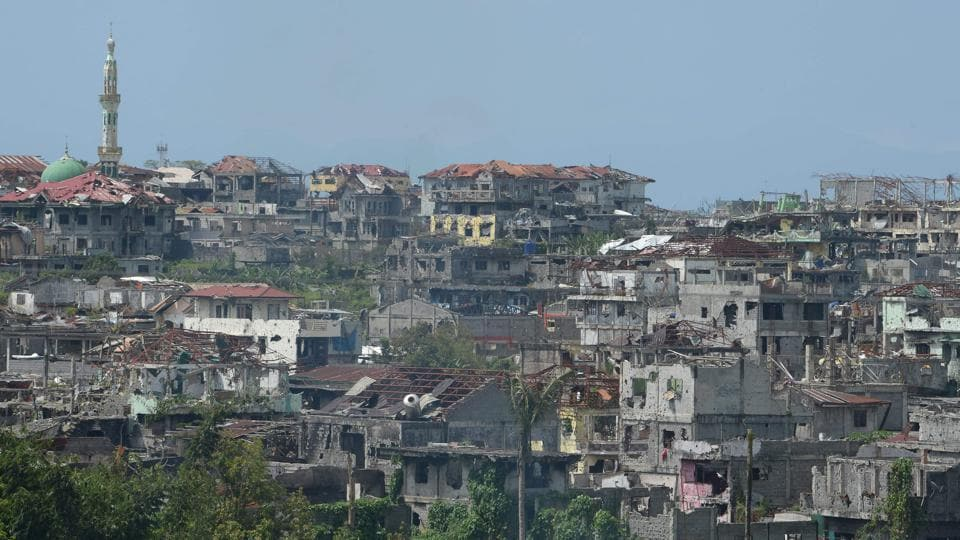 Marawi on Mindanao island, the principal Islamic city in the mainly Catholic Philippines, was besieged by hundreds of local and foreign gunmen waving black IS flags who attacked it in what authorities said was an attempt to establish a Southeast Asian base. (Ted Aljibe / AFP)
