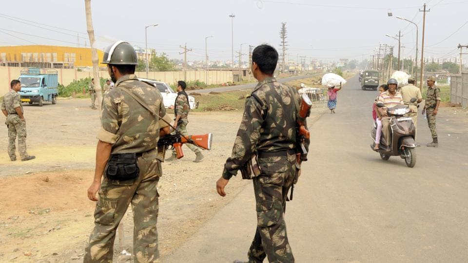 Police personnel patrol Ranigung area in Asansol after communal clashes, on April 1, 2018.