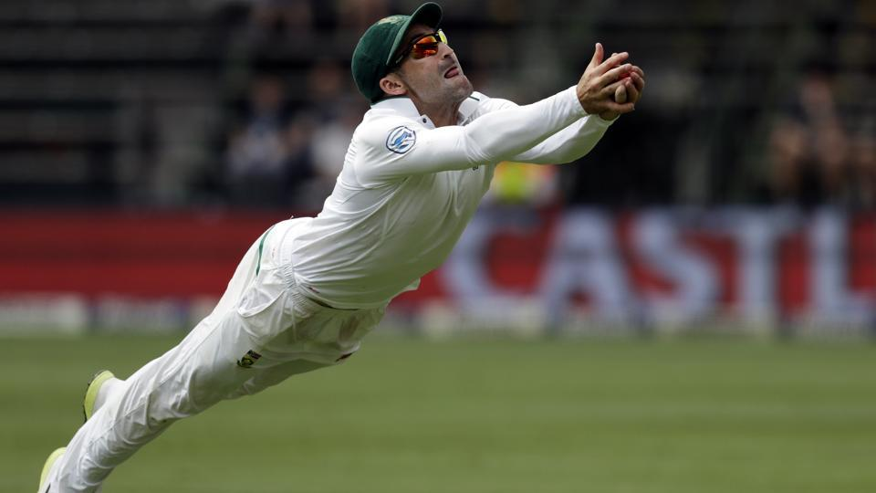 Dean Elgar took a brilliant catch of Tim Paine to dismiss him for 62 and bowl Australia out for 221 in the Johannesburg Test.