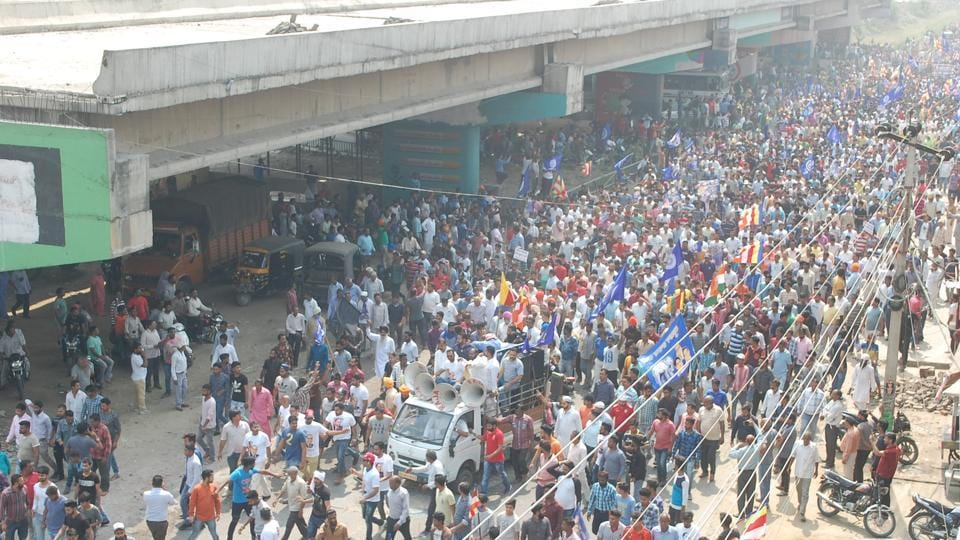 People protesting on national highway-1 in Phagwara on Monday.