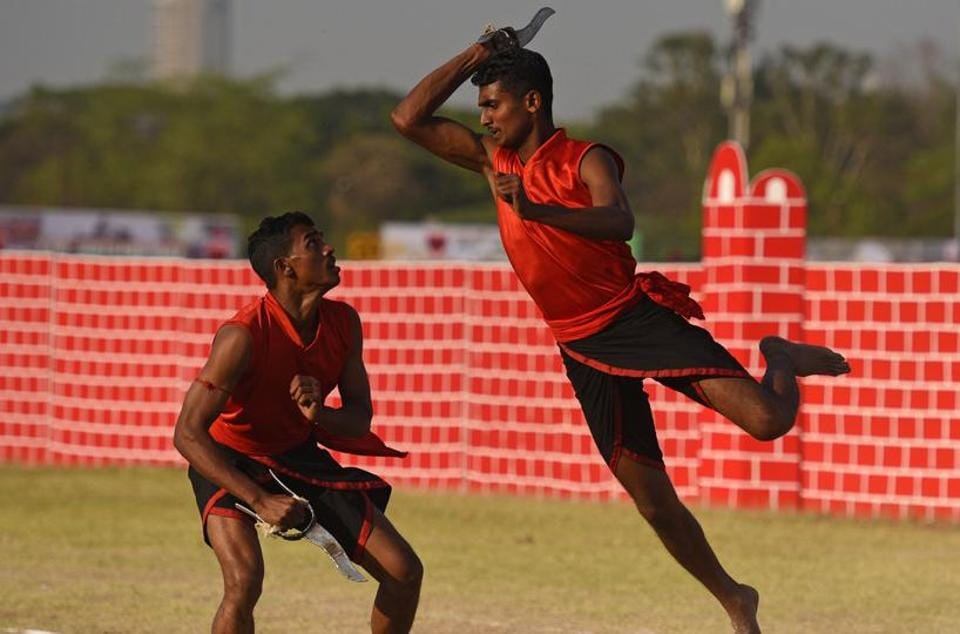 Army personnel display Kalaripayattu, a martial art form of Kerala, during the 124th Raising Day of Southern Command Military Tattoo event at Race course in Pune on March 31. (PRATHAM GOKHALE/HT PHOTO)