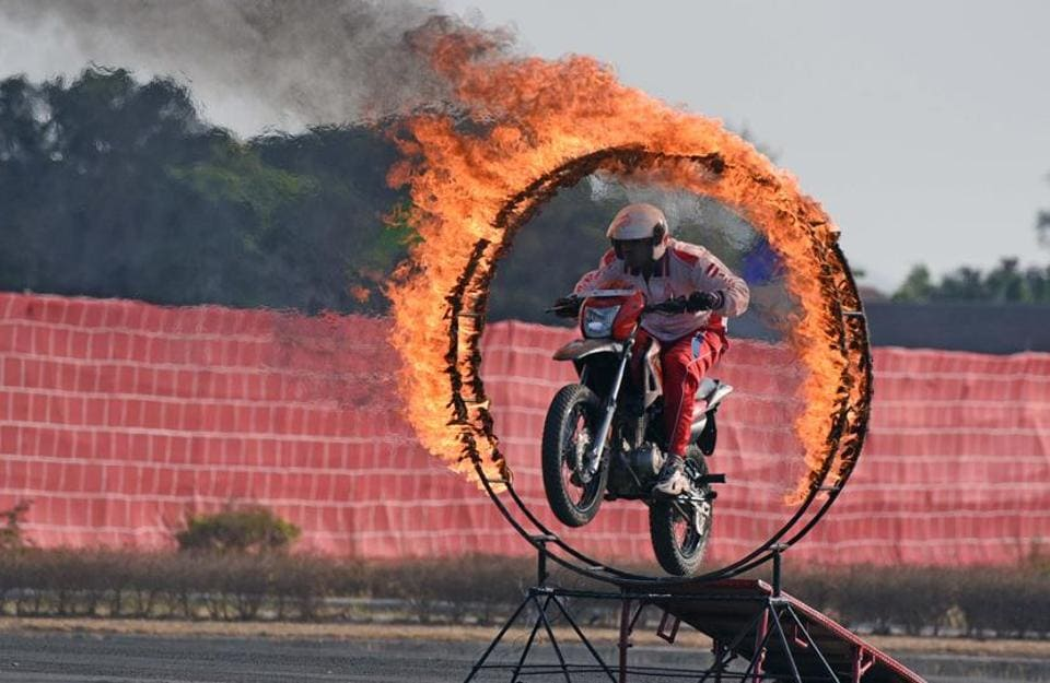 Army personnel display bike skills during the 124th Raising Day of Southern Command Military Tattoo event at Race course in Pune on March 31. (PRATHAM GOKHALE/HT PHOTO)
