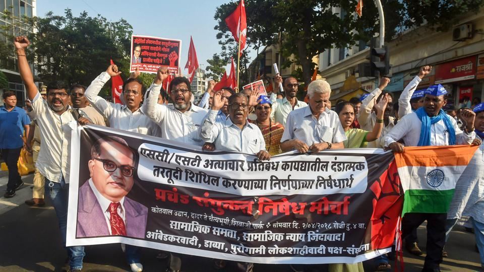 Dalit activist and supporters hold placards and raise slogans during a protest march against the alleged dilution of Scheduled Castes/Scheduled Tribes Act in Mumbai on Monday.