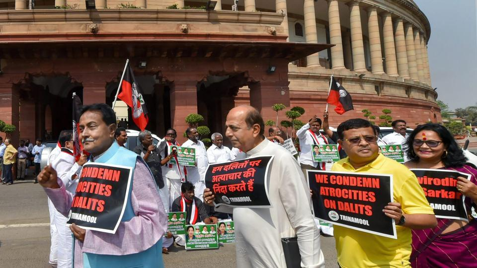 TMC leaders protest against atrocities on Dalits, at Parliament House in New Delhi on Tuesday.