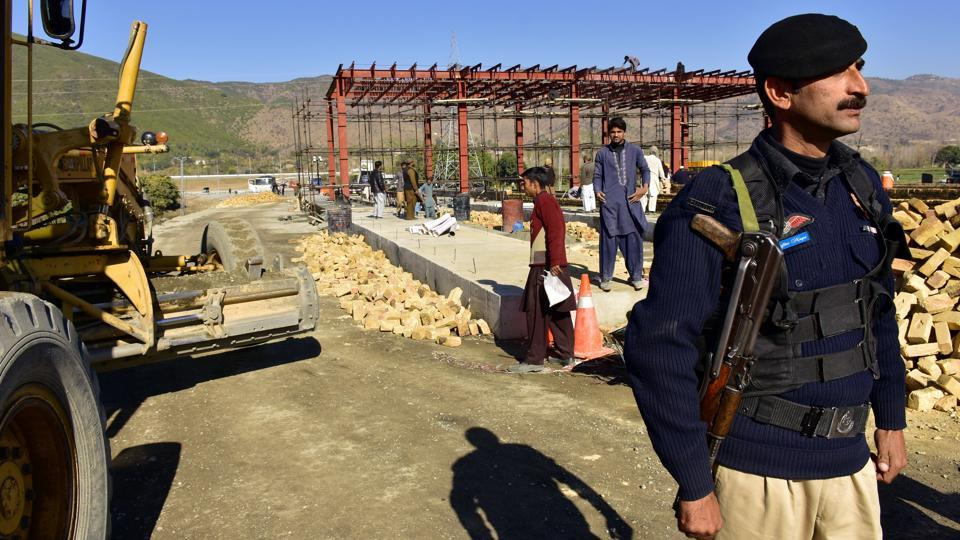 In this Dec. 22, 2017, photo, a Pakistani police officer stands guard at the site of Pakistan China Silk Road in Haripur, Pakistan