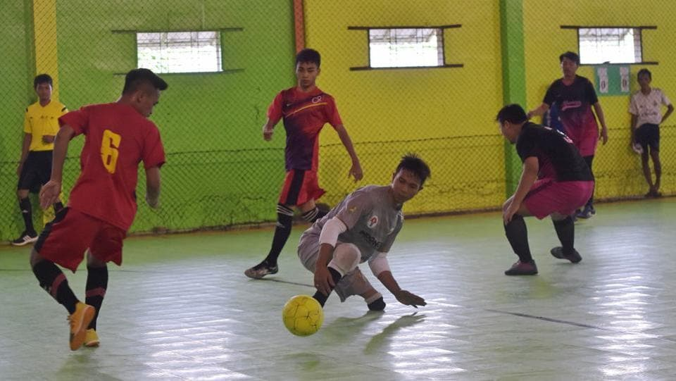Eman Sulaeman (C) attempts possession of the ball during a futsal match. His talents have caught the attention of West Java's sports agency, lifting hopes that the government might boost its support for disabled athletes.  (Adek Berry / AFP)