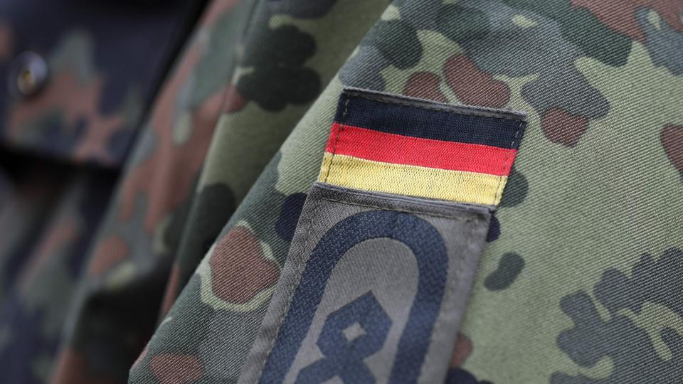 A German flag is pictured on a soldier's uniform.