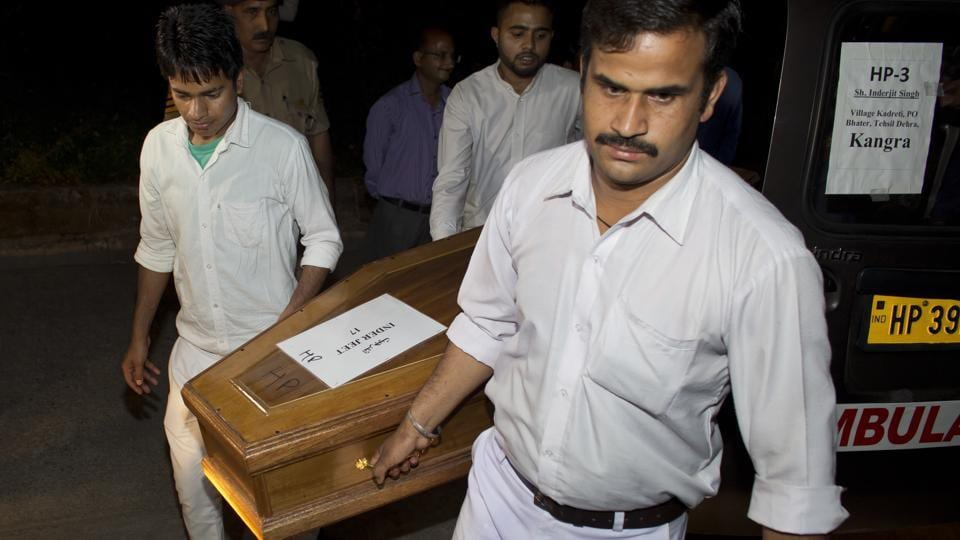 Hospital staff carry a casket containing the remains of Inderjeet at the Dr Rajendra Prasad Government Medical College at Tanda in Dharmsala. Congress leader Navjot Singh Sidhu on Monday said the Punjab government declared an ex-gratia of Rs 5 lakh, a job for one family member and the continuation of a monthly pension of Rs 20,000 for the families of the workers from Punjab. (Ashwini Bhatia / AP)