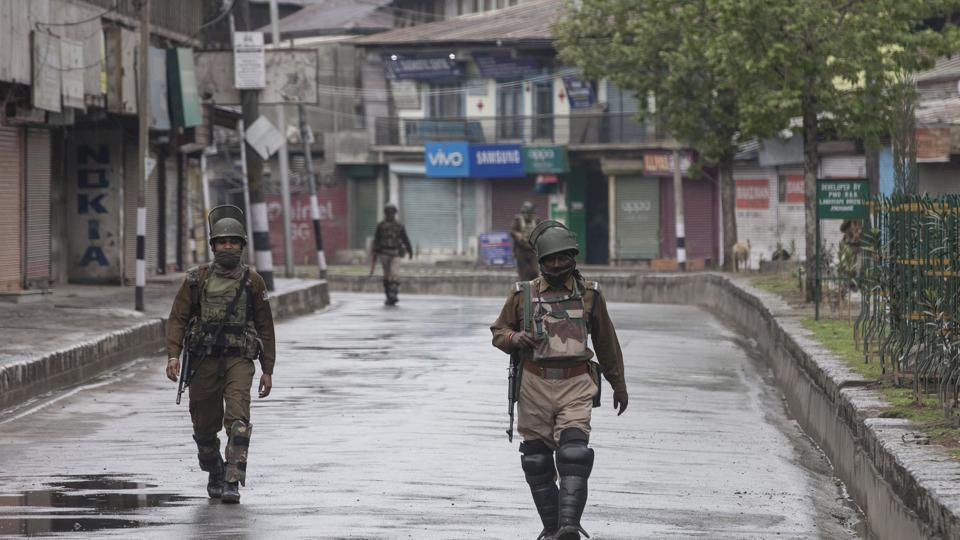 Paramilitary soldiers patrol during restrictions in downtown area of Srinagar, on Tuesday.