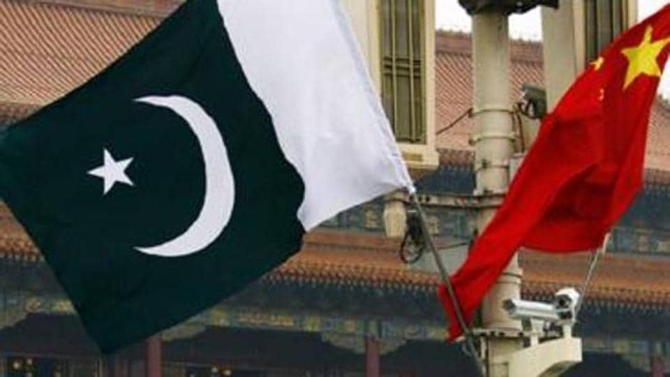 A Pakistan national flag flies alongside a Chinese national flag in Beijing's Tiananmen Square.