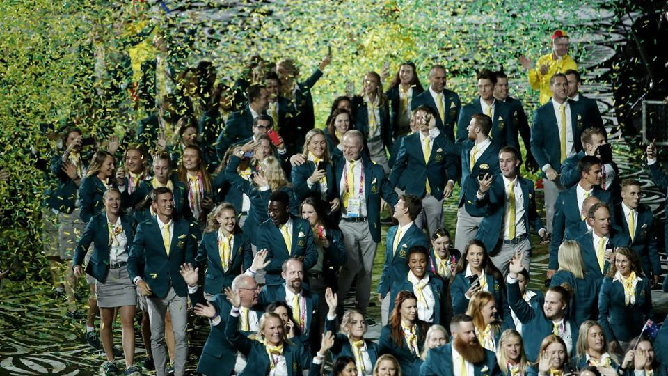 Australian athletes march into Carrara Stadium for the opening ceremon. (AP)