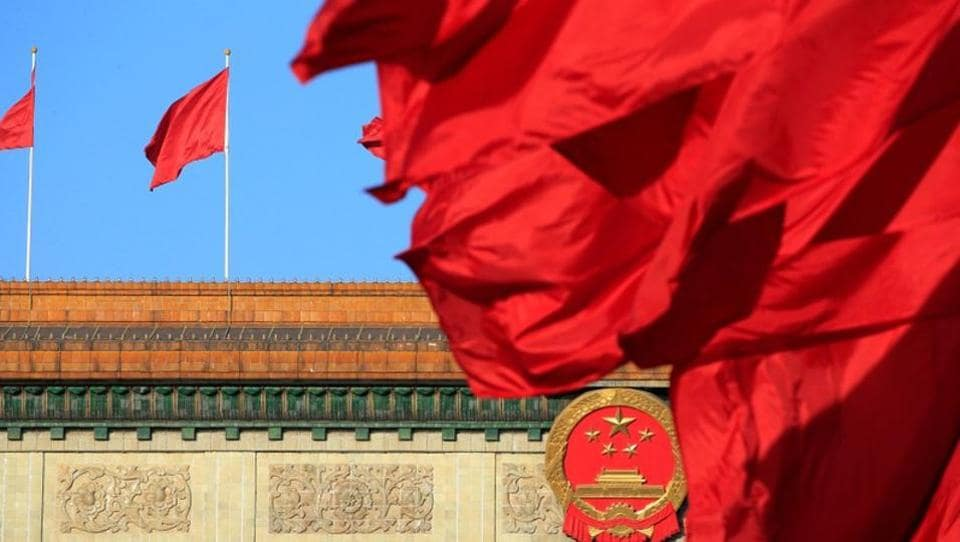 Red flags flutter outside the Great Hall of the People before the second plenary session of the Chinese People's Political Consultative Conference (CPPCC) in Beijing on March 8, 2018.