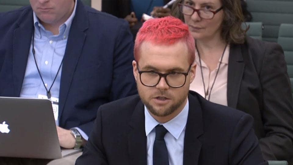 A video grab from footage broadcast by the UK Parliament's Parliamentary Recording Unit shows Canadian data analytics expert Christopher Wylie who worked at Cambridge Analytica appears as a witness before the Digital, Culture, Media and Sport Committee of members of the British parliament at the Houses of Parliament, London, March 27