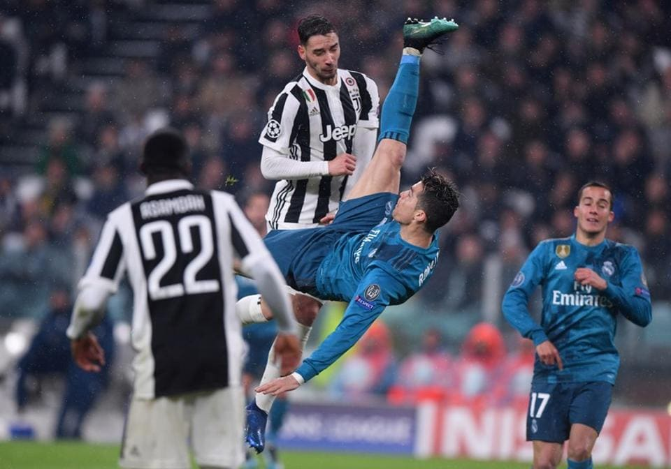 Kwadwo Asamoah and Mattia de Sciglio of Juventus could only watch on as Ronaldo's sublime effort saw the ball race into the back of the net. (REUTERS)