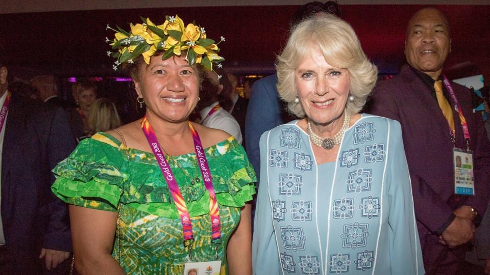 Camilla, Duchess of Cornwall, poses with Tau Estalla, a delegate from the Cook Islands, at a reception before the opening of the Commonwealth Games. (REUTERS)