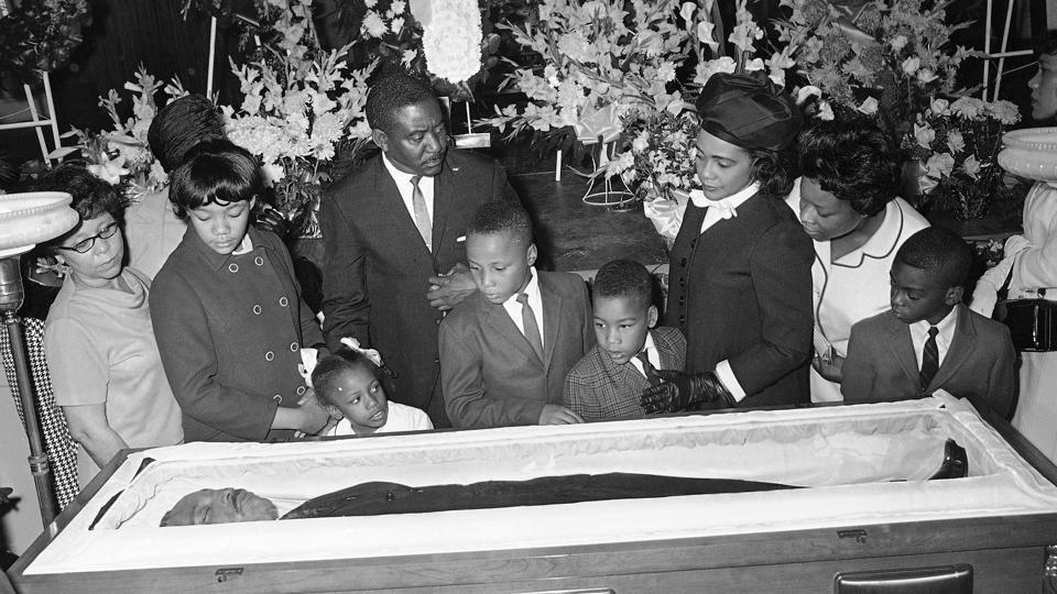 Coretta Scott King (3rd-R), third right, is accompanied by her children, Yolanda, Bernice, Martin III, and Dexter at Sisters Chapel on the campus of Spellman College in Atlanta on April 08, 1968. Martin Luther King Jr.'s family joined thousands of mourners who filed by the casket of the civil rights leader. (Jack Thornell / AP File)