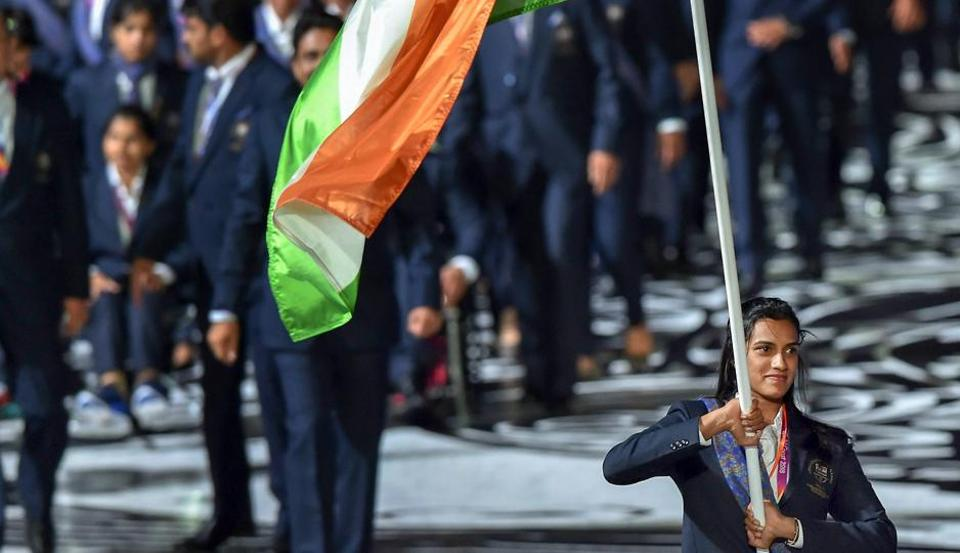 Flagbearer PV Sindhu leads the Indian contingent at Carrara Stadium during the opening ceremony of 2018 Commonwealth Games, Gold Coast. (PTI)