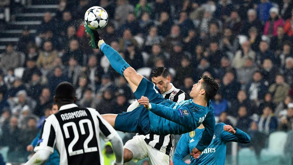 Real Madrid's Portuguese forward Cristiano Ronaldo (C) scores his overhead goal during the UEFA Champions League quarter-final first leg football match against Juventus at the Juventus Stadium in Turin on Tuesday. (AFP)