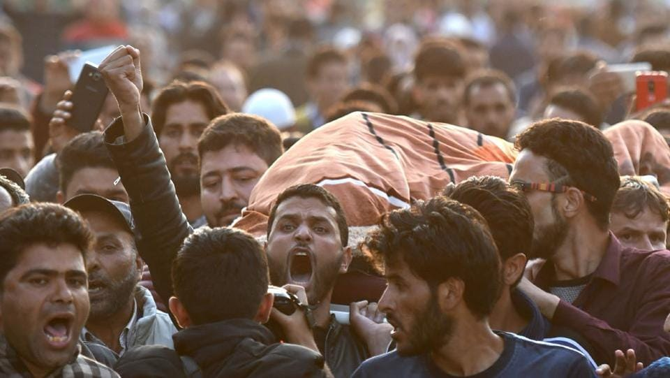 Protestors shout slogans as they carry the body of Gowhar Ahmed.