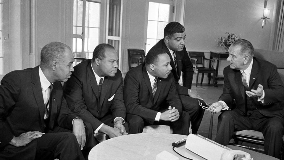US President Lyndon B. Johnson (R), talks with Martin Luther King Jr (3rd-R) and other civil rights leaders in the White House in Washington on January 18, 1964. (AP File)