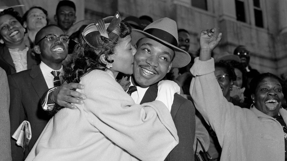 Martin Luther King Jr. is welcomed with a kiss by his wife, Coretta, after leaving court in Montgomery, Alabama on March 22, 1956. King was found guilty in the Montgomery Bus Boycott, a seminal event in the Civil Rights Movement, after Rosa Parks, an African American woman was arrested for refusing to surrender her seat to a white person in 1955. (Gene Herrick / AP File)