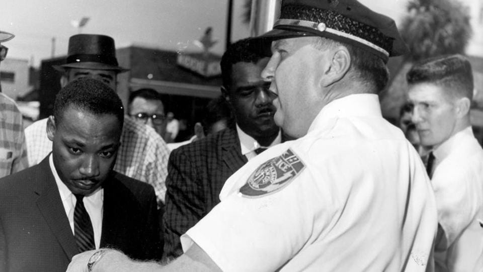 Martin Luther King Jr., is arrested by Albany's Chief of Police Laurie Pritchett after praying at City Hall in Albany, Georgia on July 27, 1962 . King participated in a month's long campaign of local anti-segregation led by the Southern Christian Leadership Conference. (AP File)