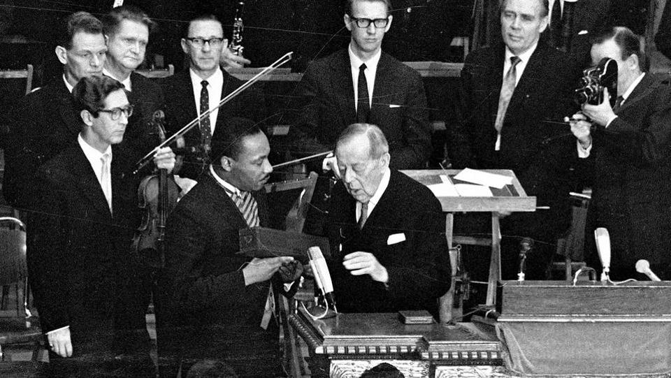 Martin Luther King Jr. receives the Nobel Peace Prize from Gunnar Jahn, chairman of the Nobel Committee, in Oslo, Norway on December 10, 1964. Its 12th American recipient, King called the prize a tribute to Americans who followed the precepts of non-violence and said during his acceptance that he regarded it a sign that world public opinion was on the side of those struggling for freedom and dignity. (AP File)