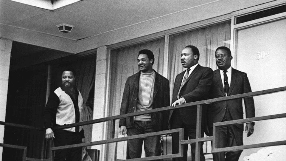 Martin Luther King Jr. (2nd-R) stands with civil rights leaders Hosea Williams, Jesse Jackson, King, and Ralph Abernathy (L-R) on the balcony of the Lorraine Motel in Memphis, Tennessee on April 3, 1968, a day before he was assassinated at approximately the same place. From left are Hosea Williams, Jesse Jackson, King, and Ralph Abernathy. (Charles Kelly / AP File)
