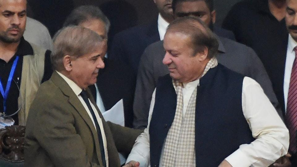 Pakistani chief minister of Punjab province Shahbaz Sharif (L), shakes hands with his brother and ousted prime minister Nawaz Sharif (R), after being elected President of ruling Pakistan Muslim League-Nawaz (PML-N) in Islamabad on March 13.
