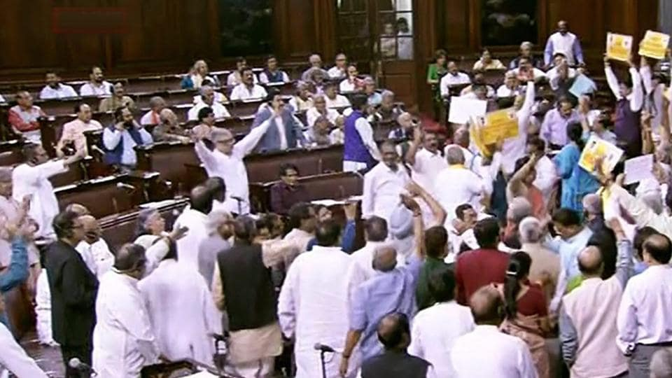 Opposition members protest in front of Rajya Sabha chairperson M Venkaiah Naidu during the ongoing budget session of Rajya Sabha, at Parliament House in New Delhi on Wednesday.