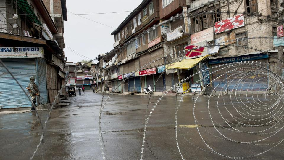A CRPF jawan guards a street in Srinagar in militancy-hit Jammu and Kashmir.
