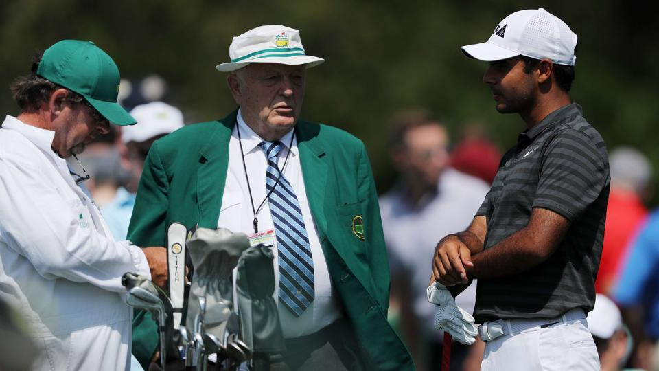 Shubhankar Sharma of India talks to Sir Ronald Hampel during a practice round prior to the start of the 2018 Masters Tournament at Augusta National Golf Club.