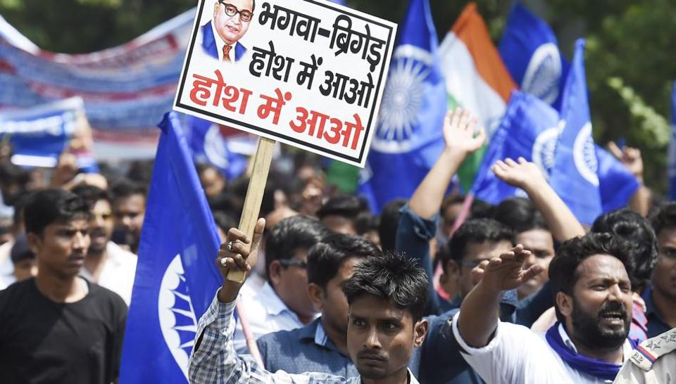 Members of the Dalit community stage a protest during 'Bharat Bandh' against Supreme Court's judgement diluting provisions of the SC-ST atrocities Act, near Connaught Place in New Delhi.