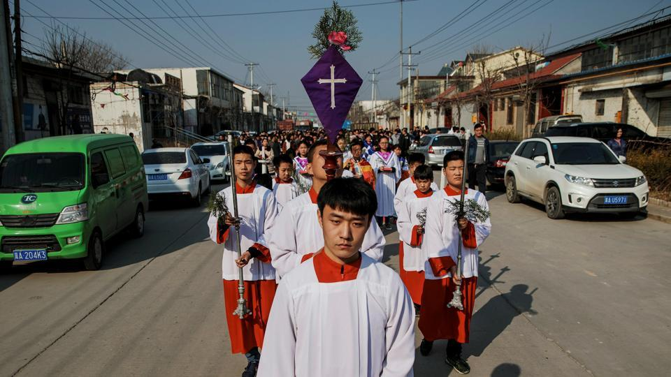 Choosing a church can be complicated in China under the officially atheist Communist Party - especially in Northern Hebei's Youtong village, where roughly half of the 5,000 residents are Catholic. Within a mile radius, the village hosts a Catholic church sanctioned by Chinese authorities, two large 'underground' churches, and numerous smaller unofficial house churches. (Damir Sagolj / REUTERS)