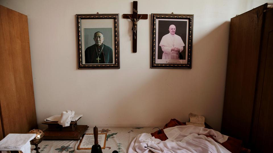 Portraits of Pope Francis and Julius Jia Zhiguo, Vatican-backed underground bishop of Zhengding diocese, are seen in the state-sanctioned church. Relations among rival churches are cordial, but villagers feel that local schisms could arise from renewed attempts to push together the state-sanctioned church which claims independence from the Vatican and underground ones loyal to Pope Francis. (Damir Sagolj / REUTERS)