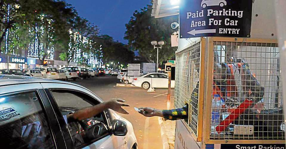 A smart parking in Sector 17, Chandigarh. As per the agreement, new rates were subject to the condition that the firm arranges electronic ticketing, adequate CCTV cameras, kiosks at entry/exit points, markings for different vehicles, sufficient number of employees, and barricading to control vehicles.