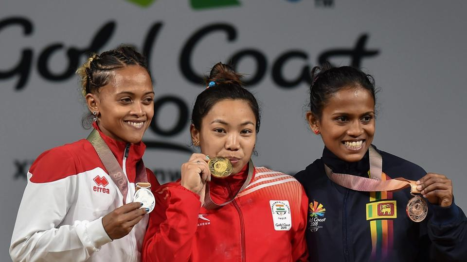 Mirabai Chanu (48kg) smashed snatch, clean and jerk and the overall Games records today to claim India's first gold in the 2018 Commonwealth Games.